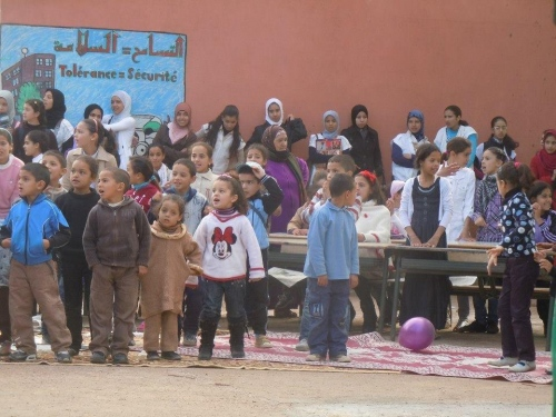 Village children gathered with their parents to watch the clowns