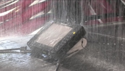 A tablet computer being subjected to water torture in a car wash.